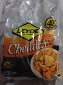 It says cheddar. It does not taste like cheddar.  I somehow still managed to eat most of it.